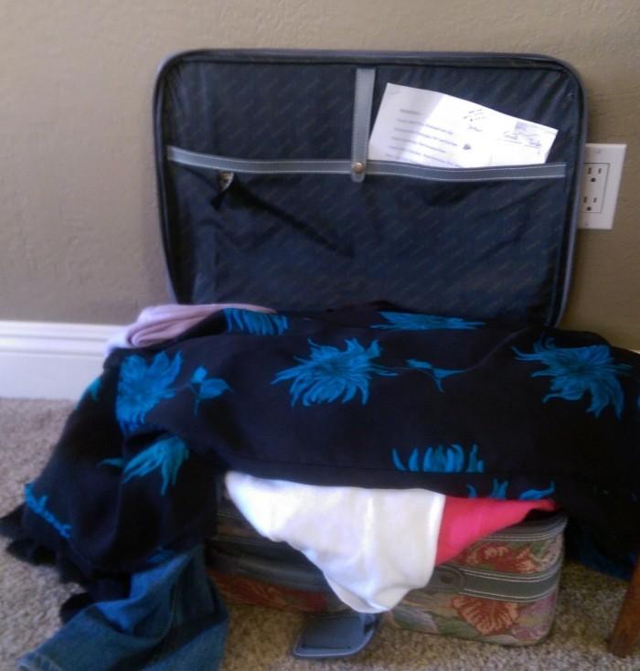 Unpacked open suitcase