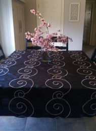 Decorative shower curtain used as a tablecloth