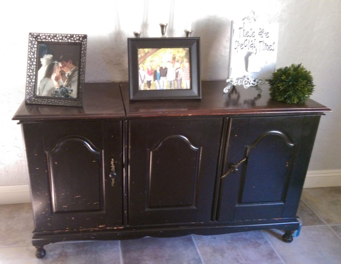 Before: Black stereo cabinet